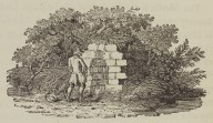 Man urinating against a wall
